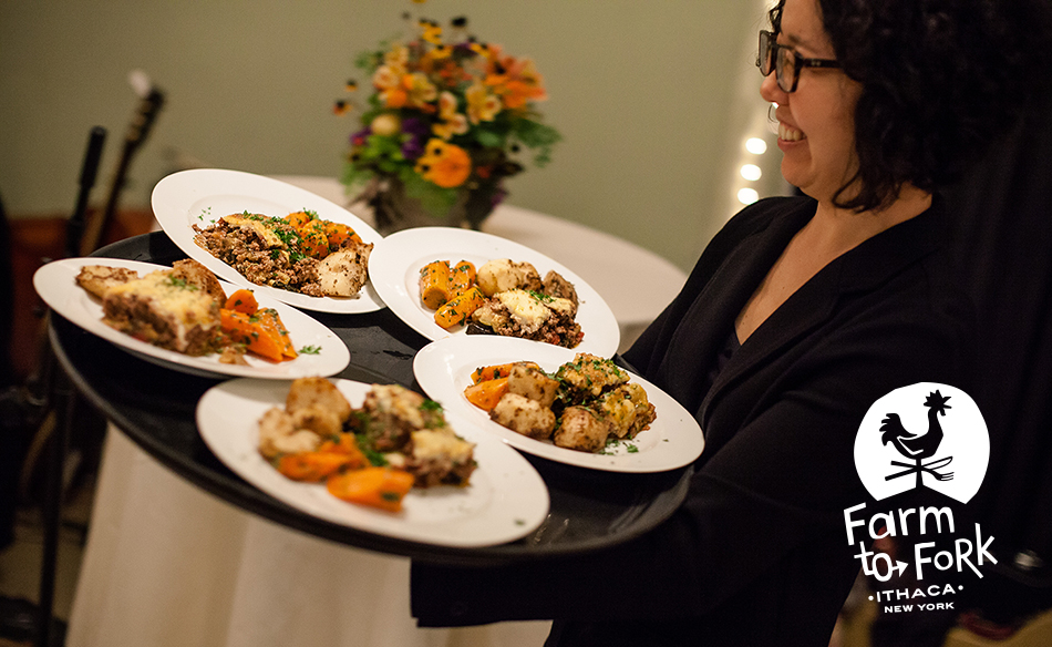 Serving a tray of farm to table plates in Ithaca