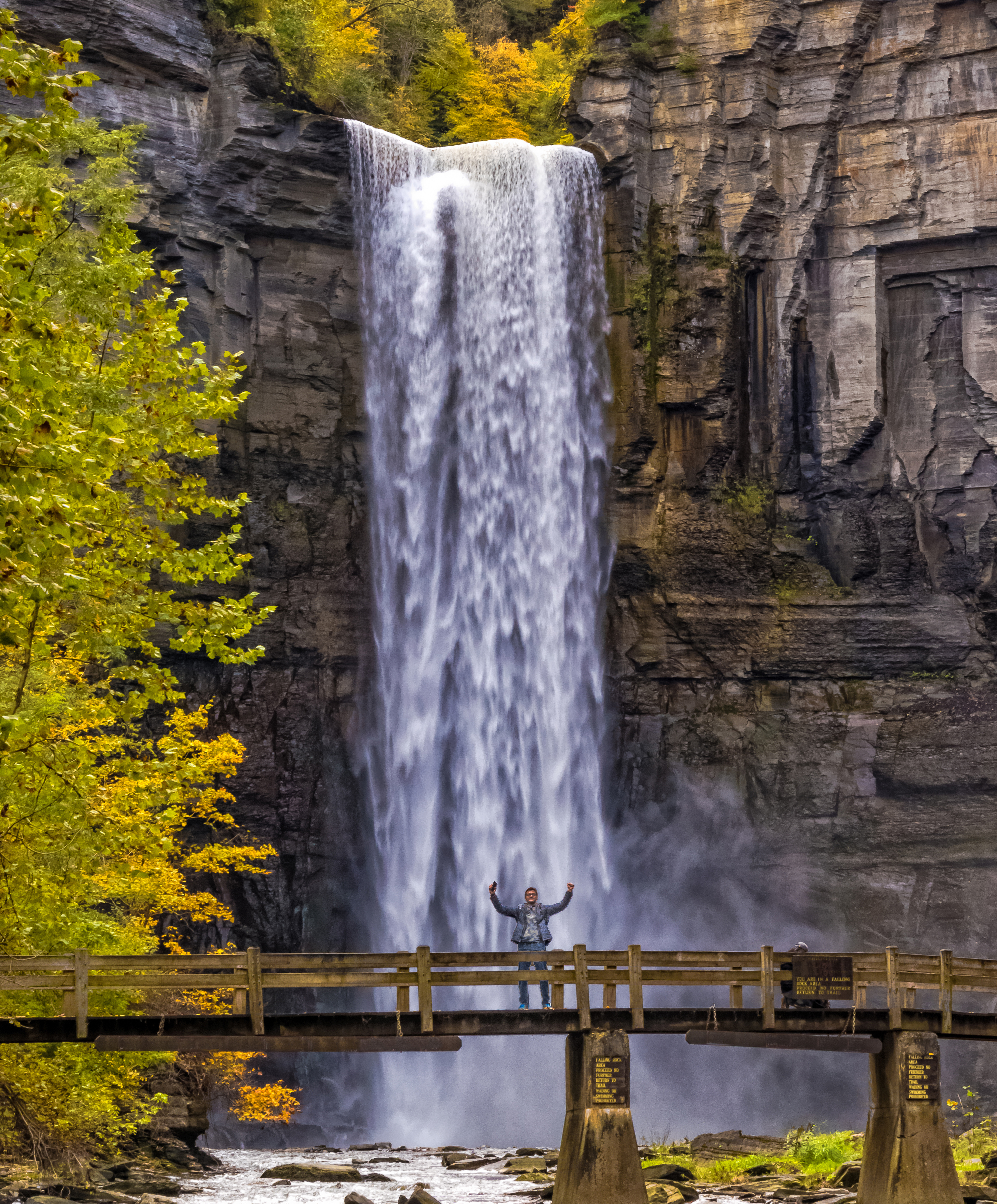 person on bridge in front of Taughannock Falls