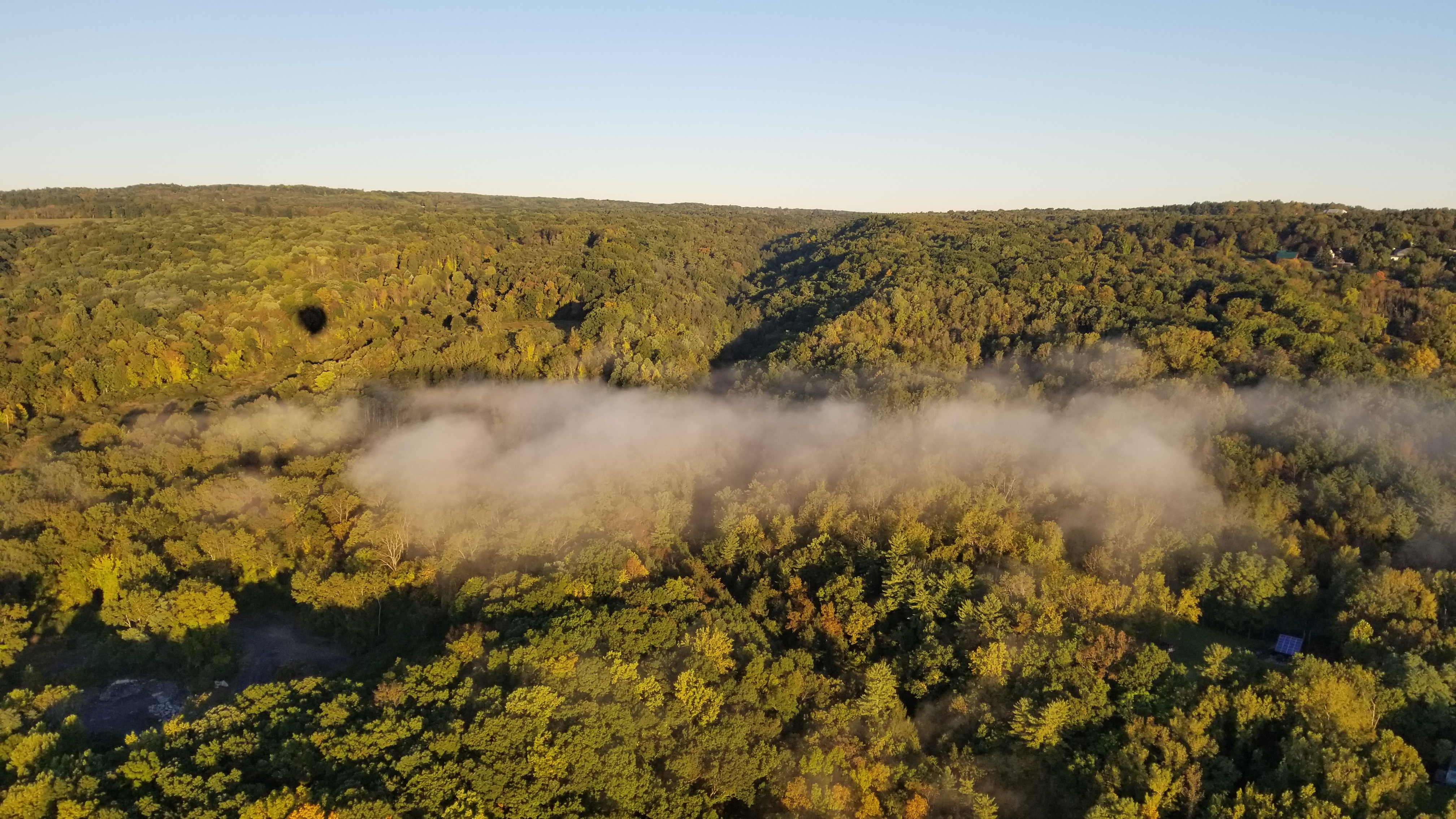 ariel view of changing fall leaves above tompkins county from Oct. 7