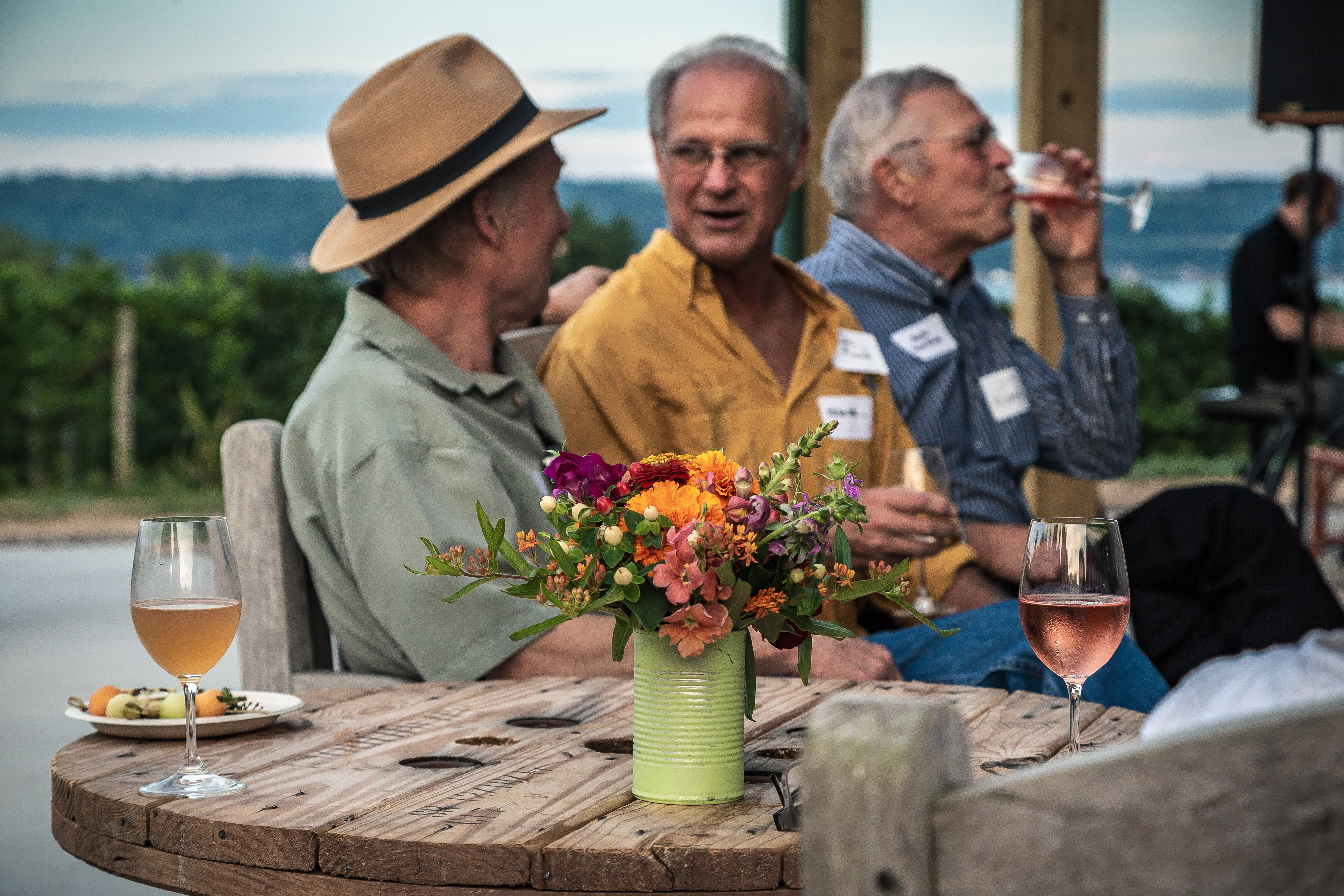 Outdoor dining with wine and appetizers at Sheldrake Point Winery in Ovid, NY