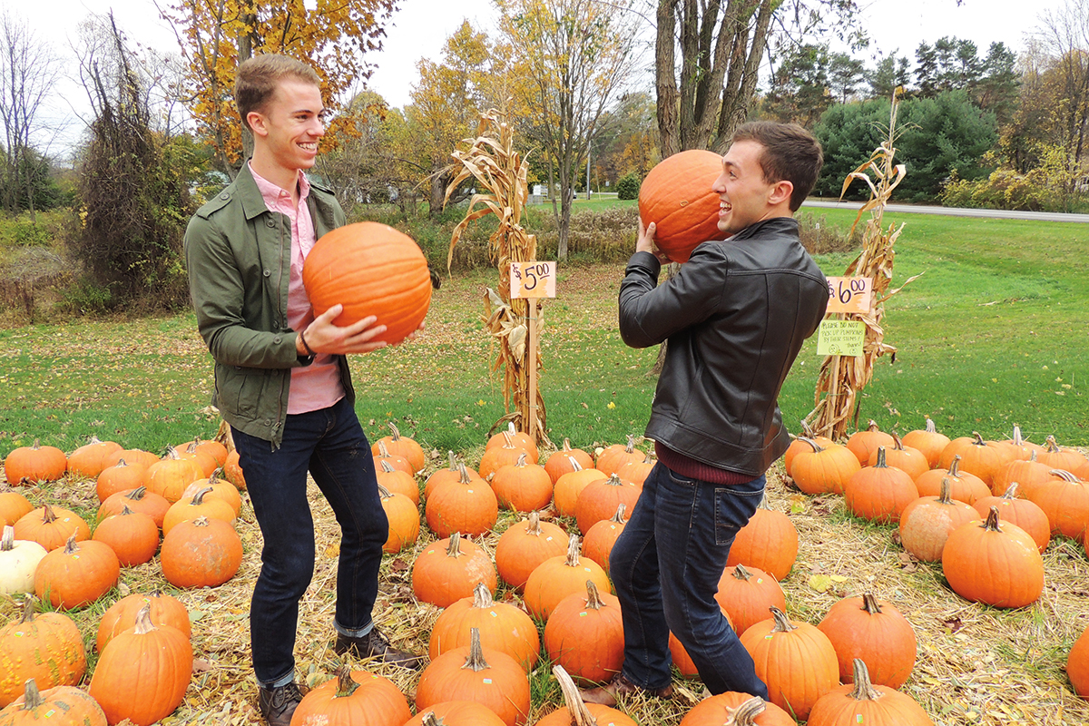 Two guys with pumpkins