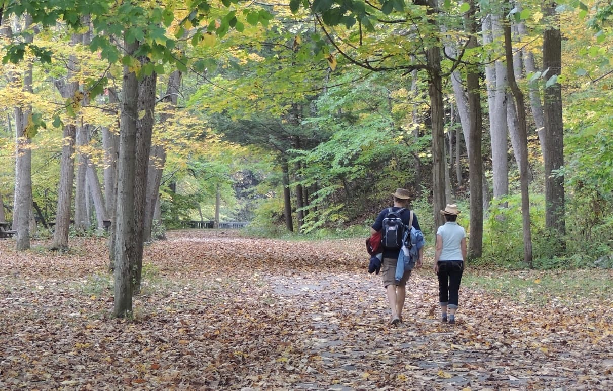 couple hiking at Robert Treman State Park in Fall