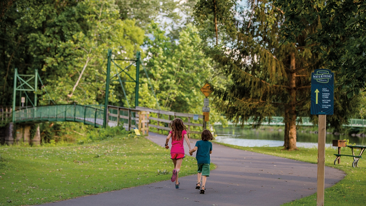 kids running on waterfront trail