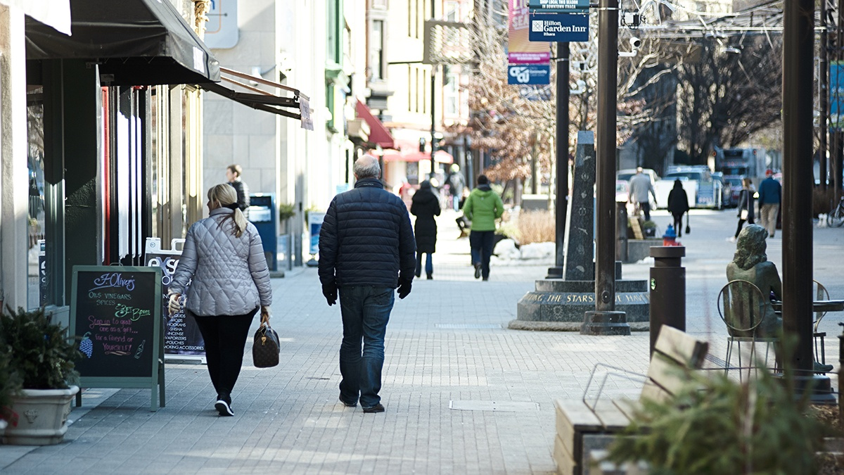 two people strolling the Ithaca commons