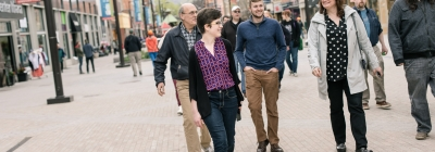 Group participating in a walking tour on Ithaca Commons