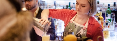 woman pouring drink at argos