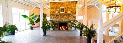 interior event space with fireplace and white beams