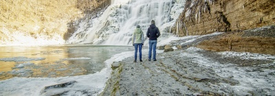 two people in front of winter Ithaca Falls