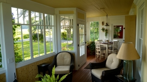 our cozy porch is one option to have breakfast